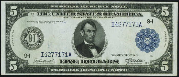 Picture of old $5 blue seal federal reserve note with Abraham Lincoln's face on it from 1914